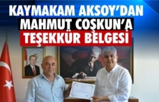 Gazeteci Mahmut Coşkun'a Kaymakam Aksoy'dan teşekkür belgesi